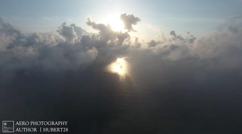 空拍機穿趣雲層看到日出的畫面很讓人震撼。