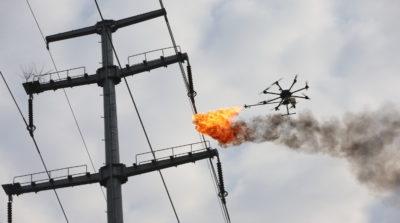 襄陽供電公司噴火無人機清理架空電纜雜物