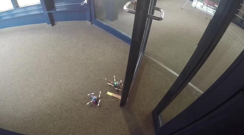 大力無人機拉動自身 40 倍重量物件 還能「合作」開門
